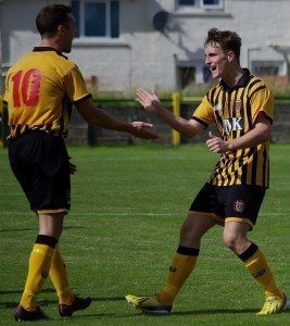 Keir Milliken congratulates Graham Wilson on scoring